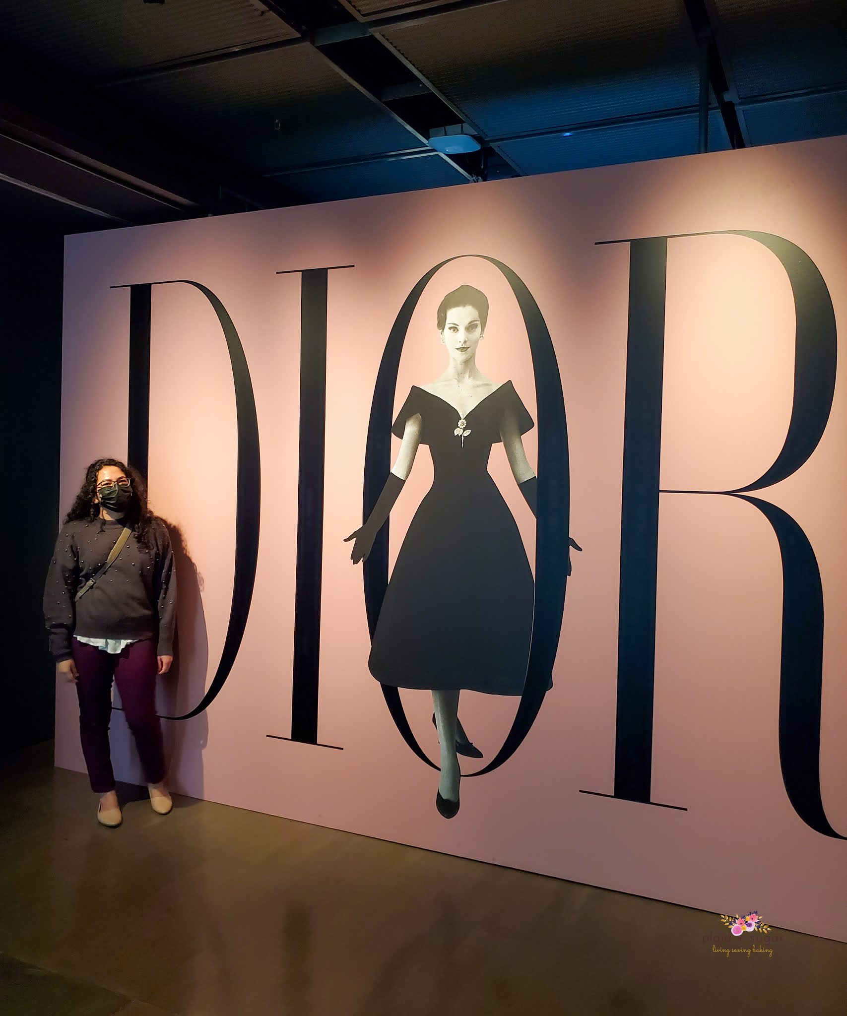 Visiting and gazing at original house of Dior garments at an exhibit in Montreal