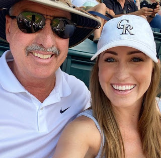 Kylie Bearse clicking selfie with her father
