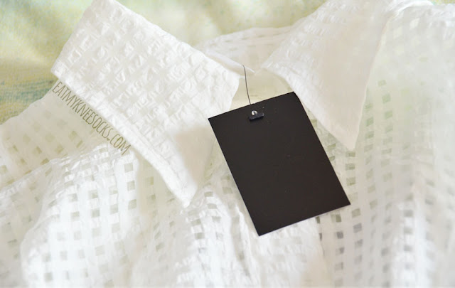 Details on the white batwing semi-sheer gridded buttoned shirt top from Twist X Turn.