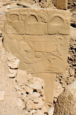 A row of ritual buckets (banduddu) depicted on Pillar 43, Enclosure D, also known as the Vulture Stone of Gobekli Tepe