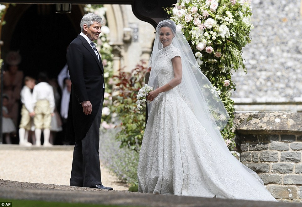 Pippa Middleton arrives at the church on her father Michael's arm for the (almost royal) wedding of the year as her groom James waits at the church door alongside best man brother Spencer