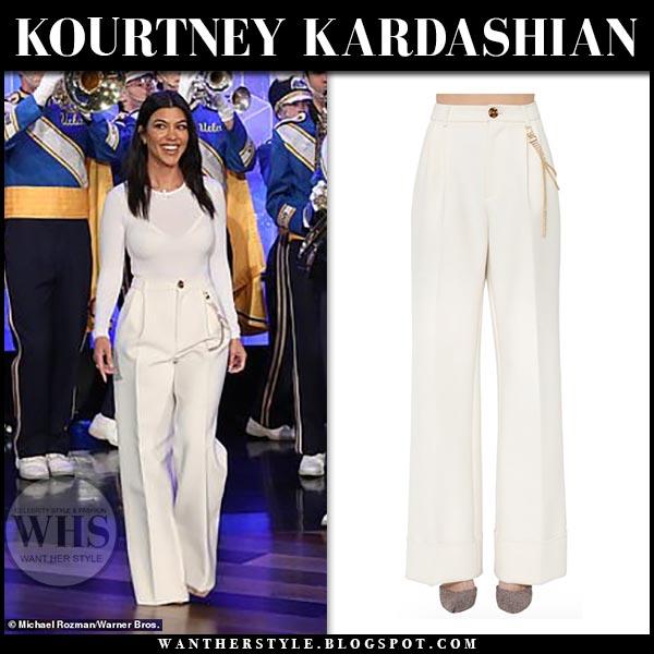 fa48d20e563b8c Kourtney Kardashian in white wide leg Area pants and white top. Celebrity  spring outfit 2019. Kourtney Kardashian on Ellen DeGeneres ...