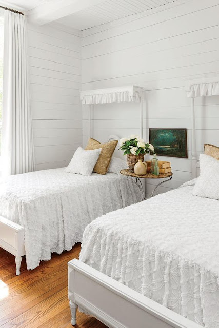 Modern farmhouse all white bedroom with shiplap walls and twin beds - found on Hello Lovely Studio