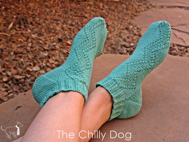 Switchback Socks knitting pattern - hit the trail in a summery pair of women's socks that feature zigzags cascading down one side of each sock.