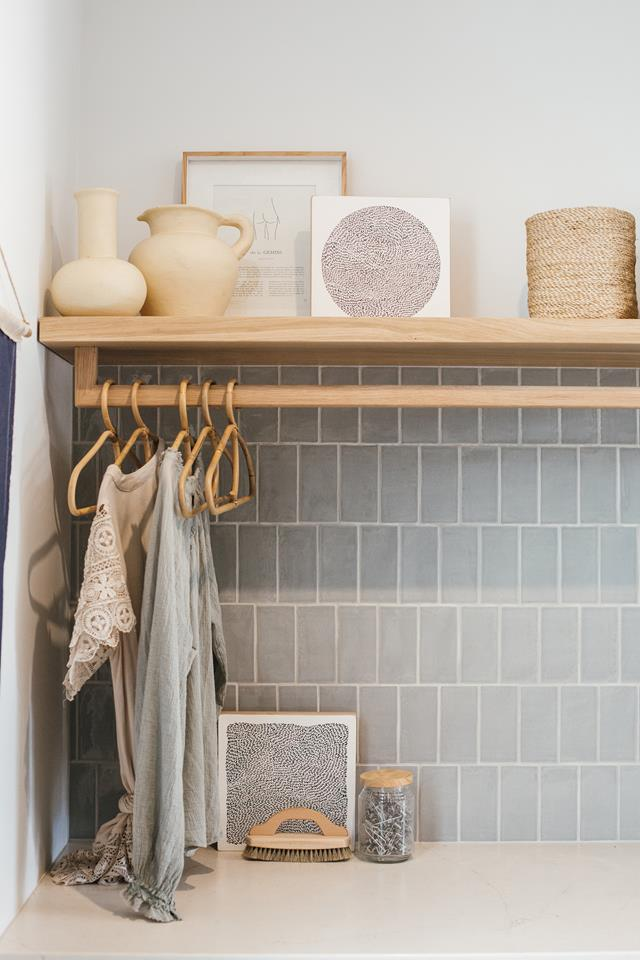 Subway tile backsplash and hanging rack in the laundry room