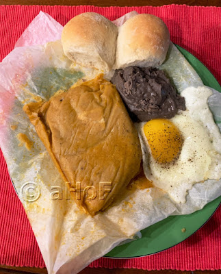 Pache for breakfast with egg, beans and pan frances