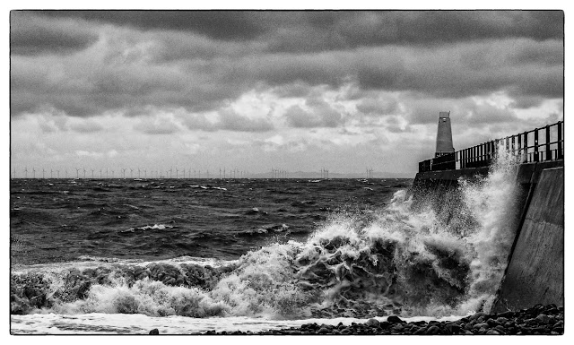 Black and white image of wild weather at Maryport