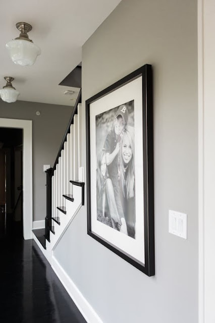 Hallway with large framed photograph on grey wall on Hello Lovely Studio