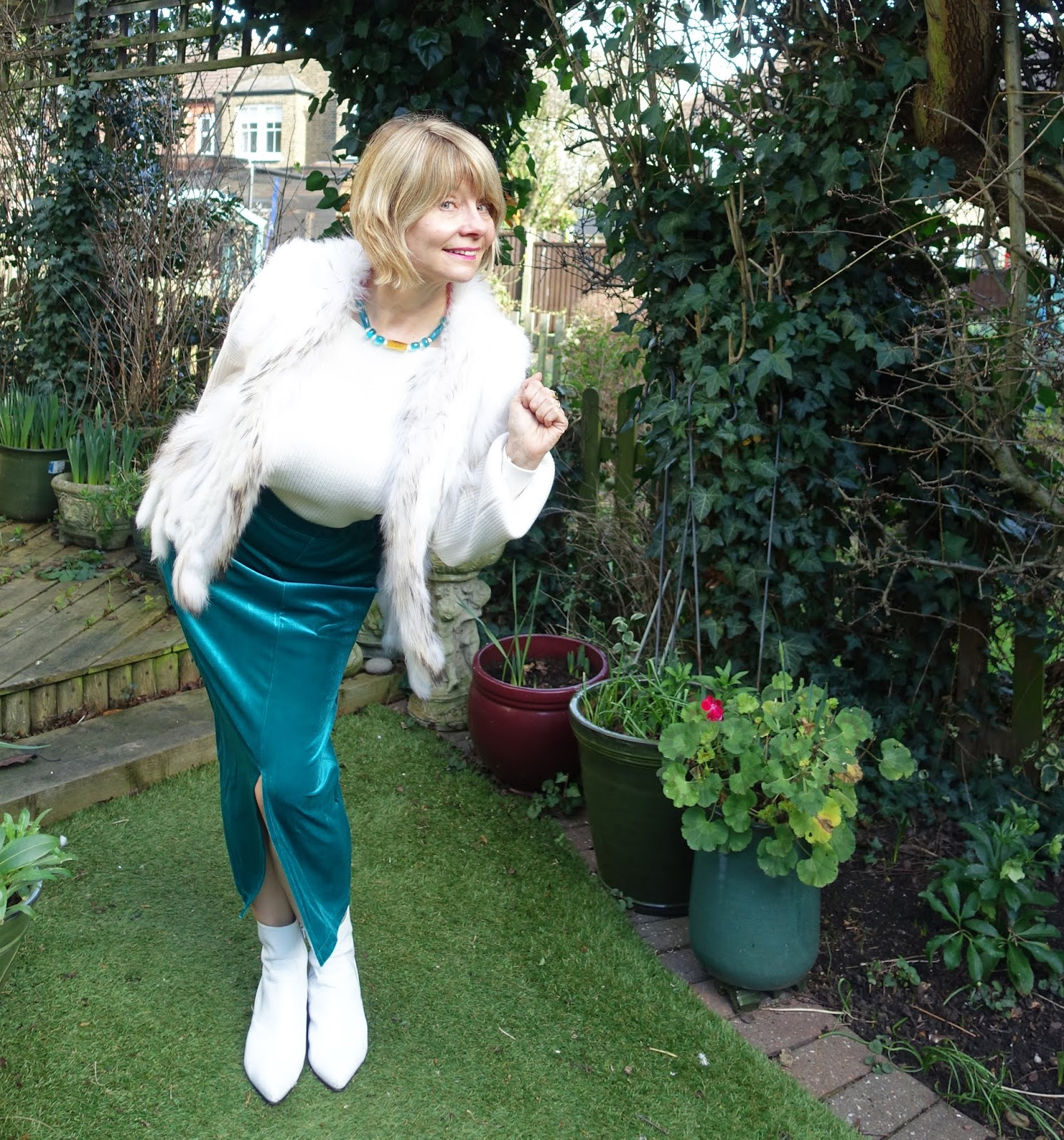 Flattering for all sizes the Zandra skirt from Kettlewell in Atlantis worn with white fur gilet and sweater by over-50s blogger Gail Hanlon