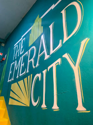 The Emerald city sign on wall of Queen of Hoxton