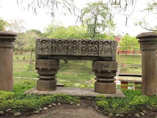 Ancient Stone pillars in chitra lekha udyan showing various deities