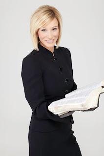 Paula White holding an open book