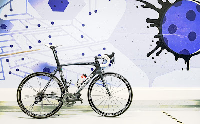 A road bike and a mural looking like a virus