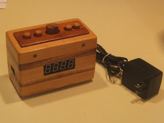http://shortcircuitprojects.blogspot.com/2013/12/arduino-powered-alarm-clock.html