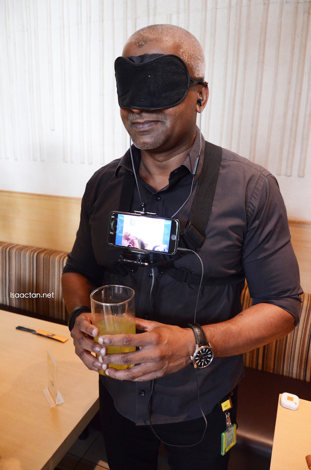 One of our activities where we were literally blindfolded and guided via voice through Skype to serve the customer her drink