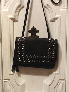 leather o-ring crossbody with tassel