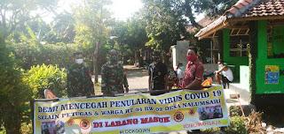 Anggota Koramil 05/Mayong Berjaga Di Pintu Lokcdown Warga Desa Nalumsari