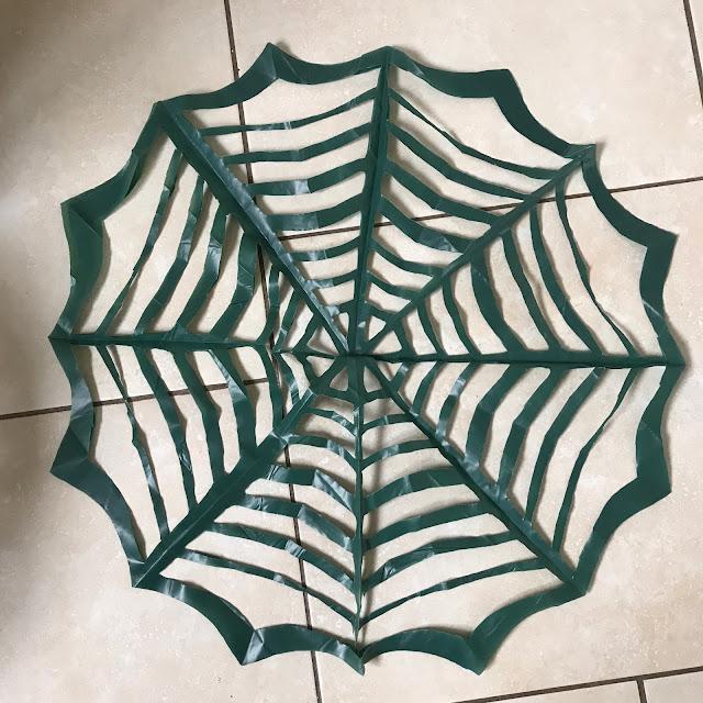 black sack spider webs DIY Halloween Crafts