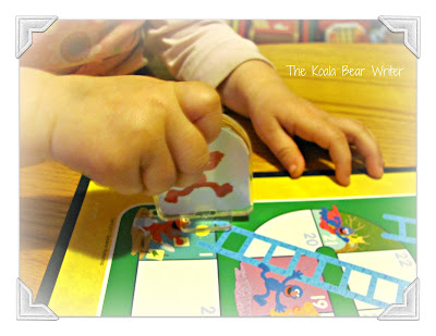 Playing board games with preschoolers - teaching a toddler how to play Chutes & Ladders