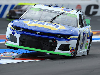 Chase Elliott bounces over the curb in the chicane during second practice for Sunday's Monster Energy NASCAR Cup Series Bank of America ROVAL 400 at Charlotte Motor Speedway.