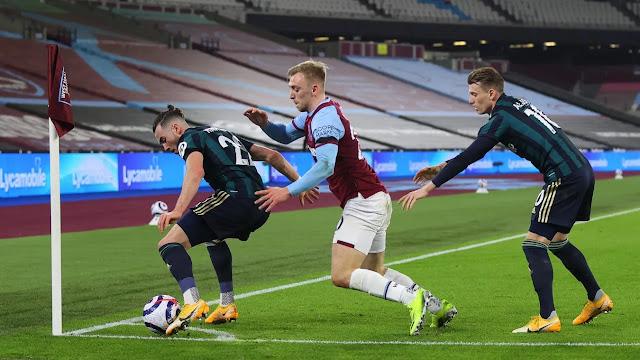 Leeds defender in action agaisnt west ham