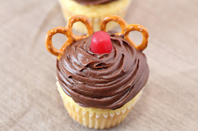 looking down on a cupcake decorated to look like Rudolph the red nose reindeer