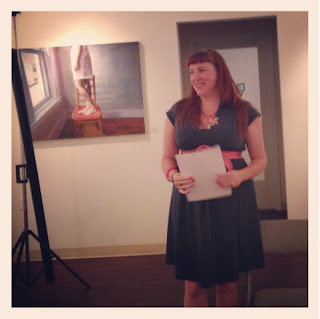 Bridget Eileen reads her poetry at the U Forge Gallery in Jamaica Plain as part of the Mr Hip Reading Series in Boston, Massachusetts