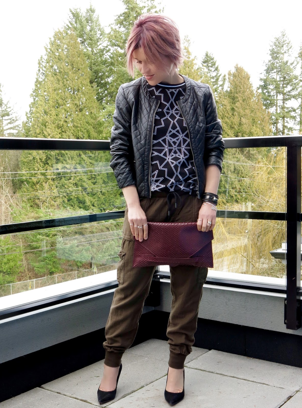 styling slouchy cargo pants with a patterned tee, quilted pleather jacket, and Sam Edelman pumps