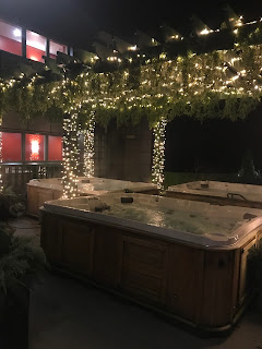 dreamy outside hot tub with fairy lights