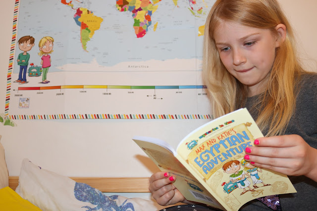 A child engrossed in the Ancient Egypt adventure story book which comes in the Mysteries in Time subscription box