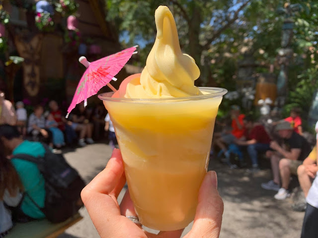 Enjoying a Dole Whip at Disney