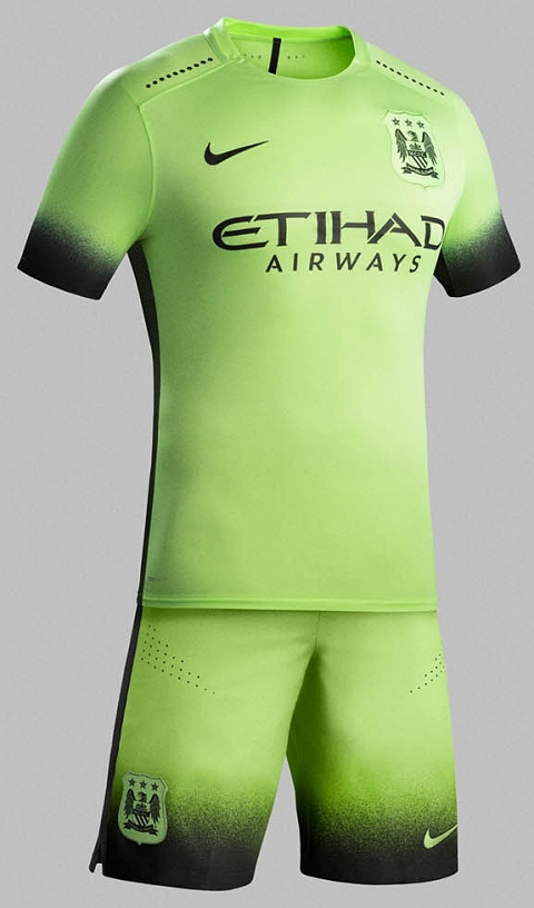 d1f9251a ... on the Manchester City 15-16 Third Shirt is recolored in black and  light green, and surrounded by the iconic shield in light green, while the  Nike and ...