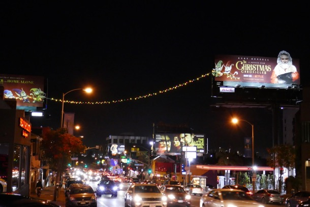 Christmas Chronicles festive string lights billboards