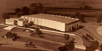 Architect's rendering of original museum building shows multiple sections, roadway, and surrounding countryside