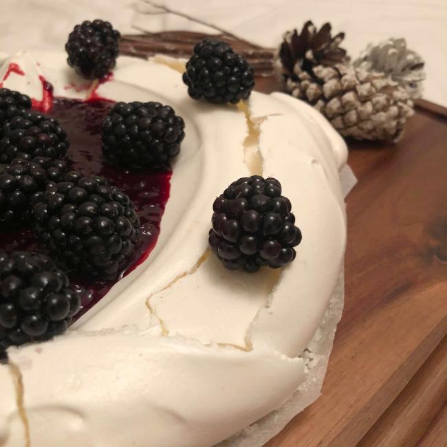 Homemade meringue with blackberries on top