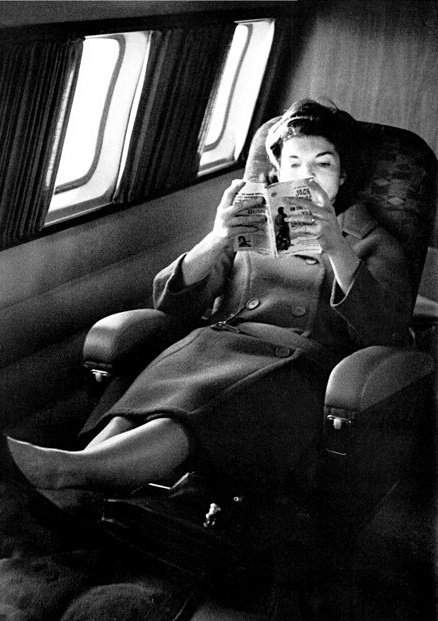 Jackie Kennedy Onassis reading a book