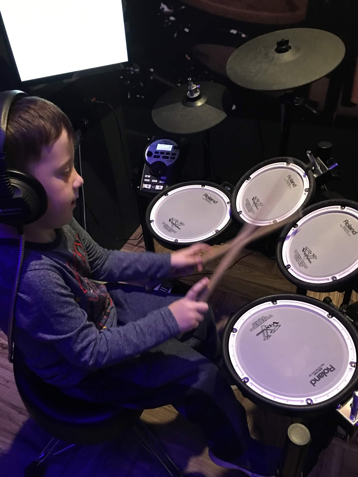 Boy playing Drums at the British Music Museum
