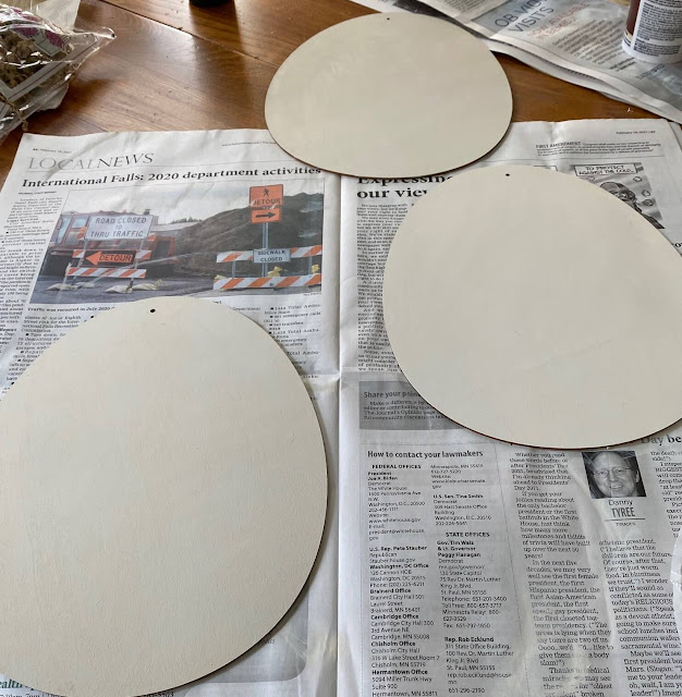 Photo of three Easter egg cutouts painted off white