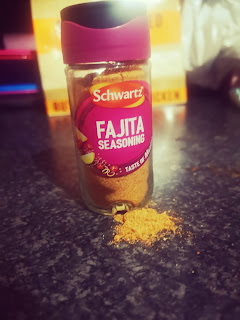 Schwartz Fajita Seasoning On a black granite kitchen top.