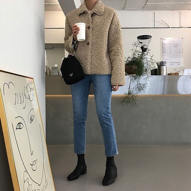 Stylish Coffee Run Outfit Idea From Instagram — Faux Fur Shearling Jacket, nylon Prada bag, cropped jeans, and black ankle boots