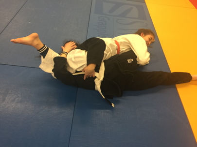 Girl pinning with sankaku (triangle choke)