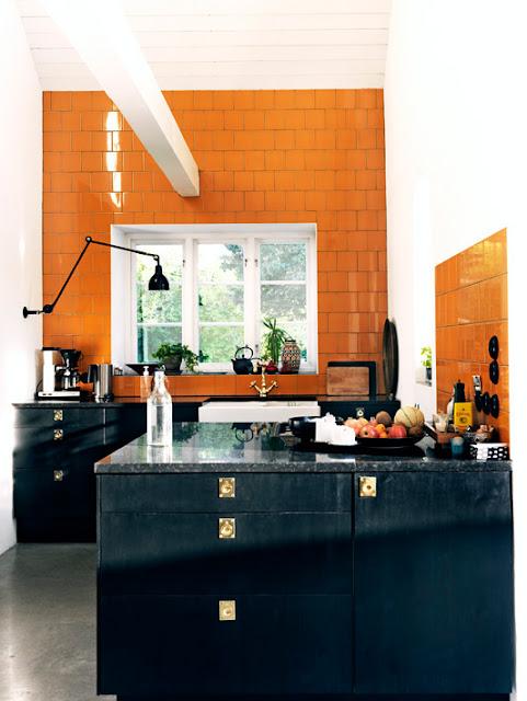 kitchen orange ceramic wall tiles black cabinetry cabinets gold drawer pulls knobs
