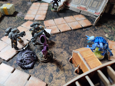 016 - Genestealer found Space Marines closing an entrance