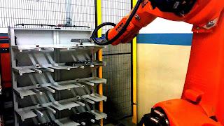 titanyum ortopedik implant besleme robotu KUKA