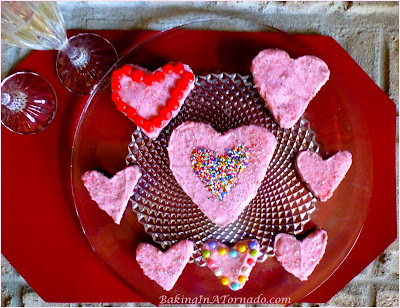 Raspberry Fudgy Brownie Hearts, Heart shaped raspberry infused brownies with a raspberry flavored frosting. Use a heart shaped cookie cutter or just cut in squares | Recipe developed by www.BakingInATornado.com | #recipe #chocolate #ValentinesDay
