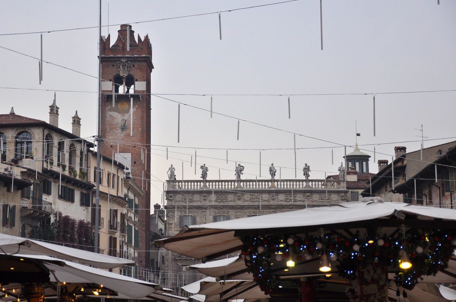 Christmas stalls and decorations, Piazza delle Erbe, Verona, Italy