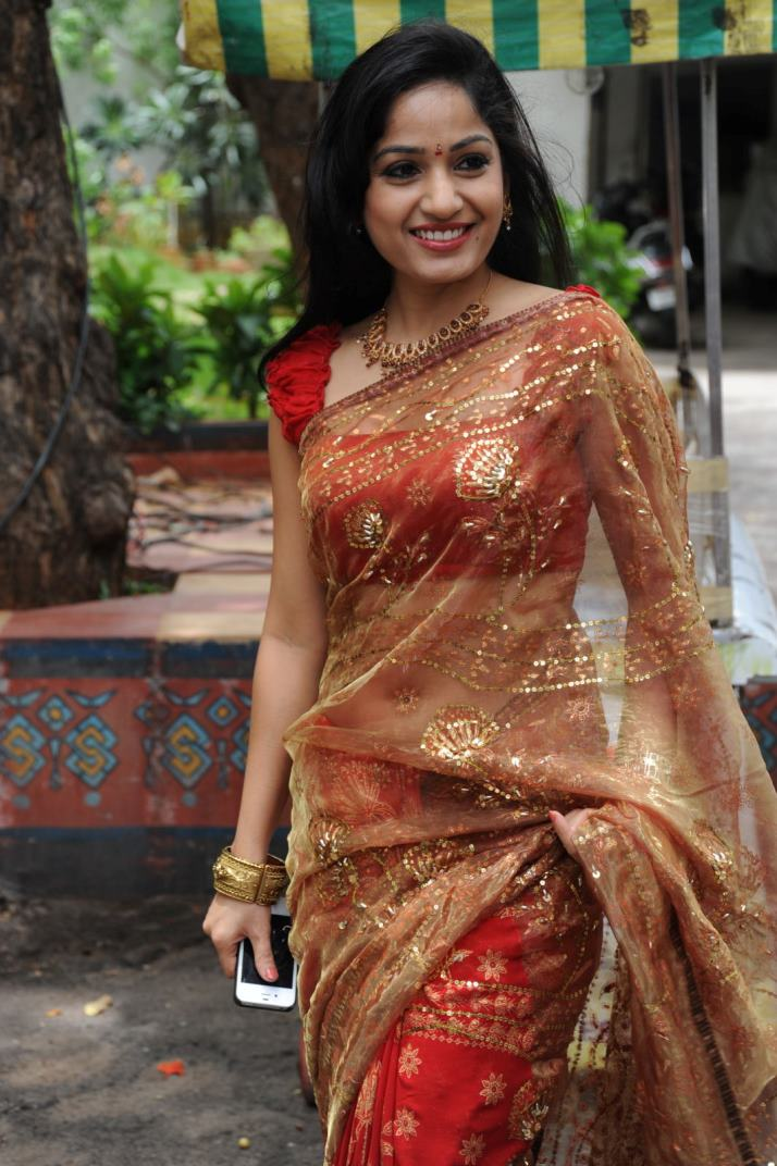 Gorgeous desi diva Madhavi latha hot photos in red transparent saree