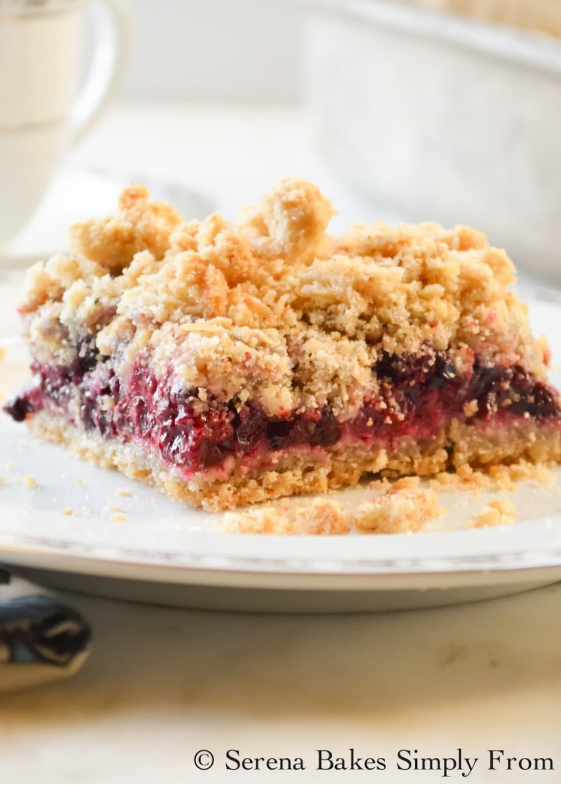 Blackberry Crumb Bars on a white plate.