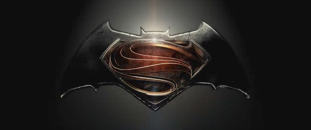 The stylized S from the new movie Superman insignia set withing a large, squat bat shape