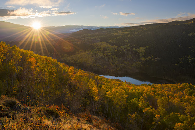 Colorado autumn sunrise with the sunbeam and upper cataract lake eagles nest wilderness fall